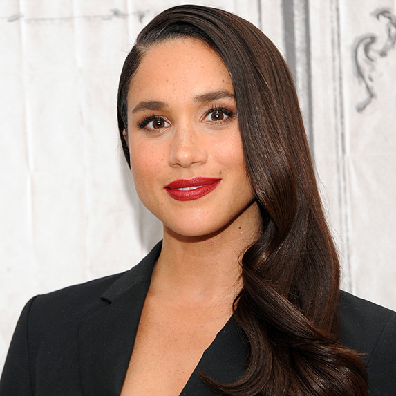 meghan markle with sleek hair and red lipstick