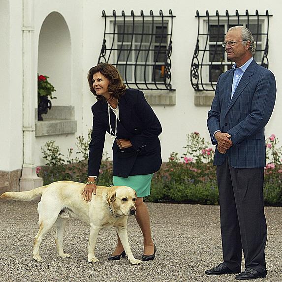 Queen Silvia, King Carl XVI Gustaf and their dog