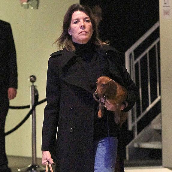 Princess Caroline of Hanover carrying dog