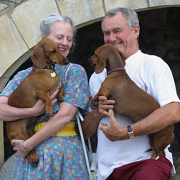 Queen Margrethe II and Prince Henrik and two dogs