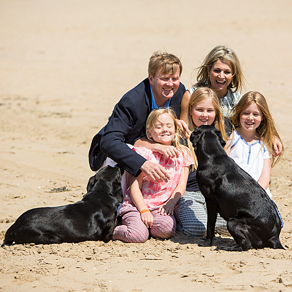 King Willem-Alexander, Queen Maxima, their kids Princess Ariane, Princess Amalia and Princess Alexia and two dogs