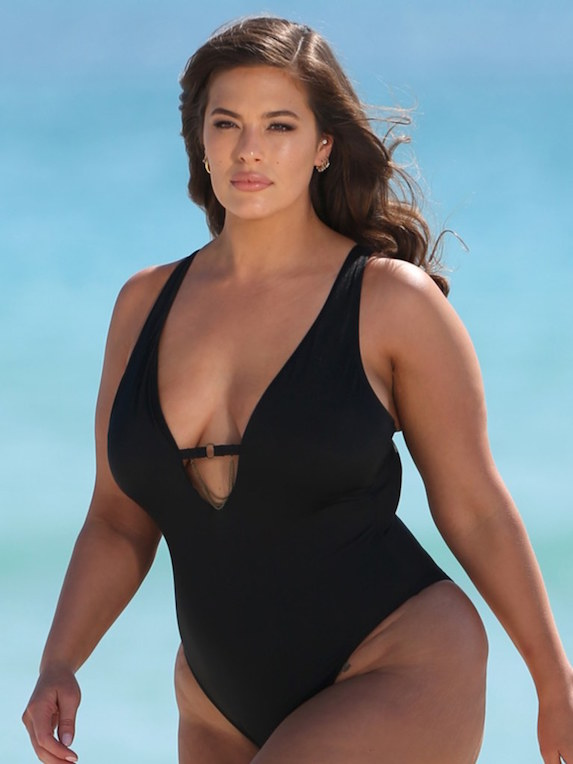 Model Ashley Graham wears a black one-piece swimsuit from her own collection