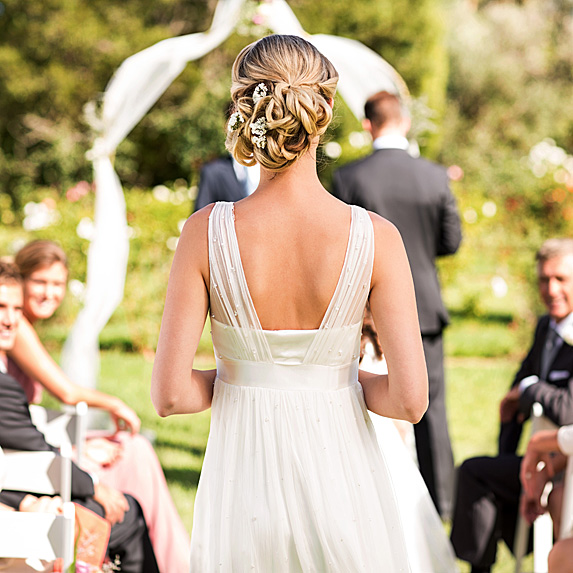 Bride walking up aisle by herself