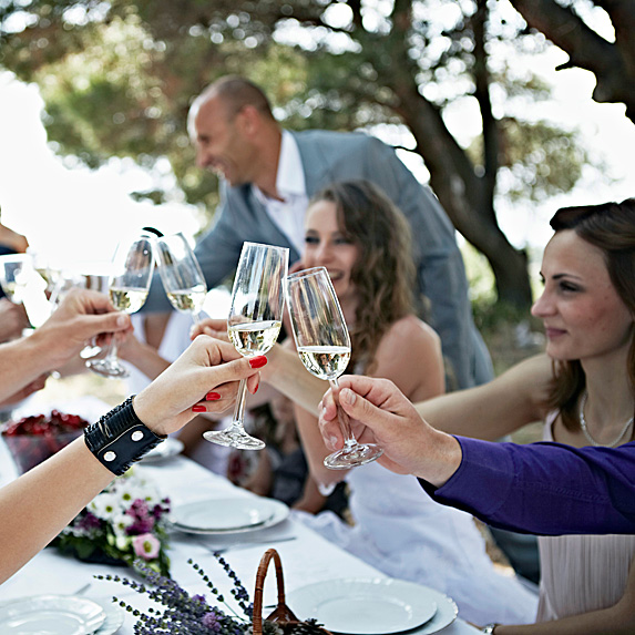 Wedding guests at table drinking champagne