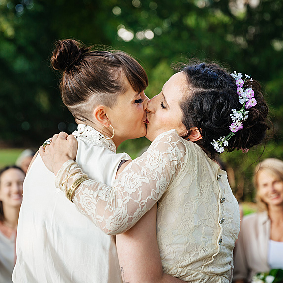 Two women kissing after exchanging vows