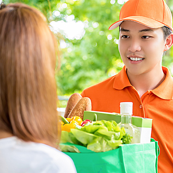 Woman receiving grocery delivery