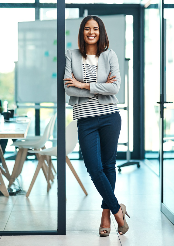 Confident woman standing in office