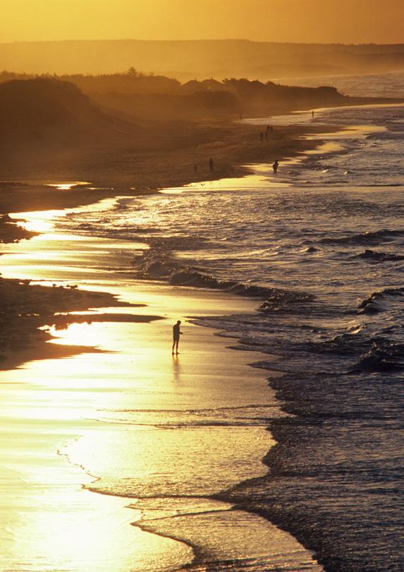 Person walking the beach in Cavendish, Prince Edward Island