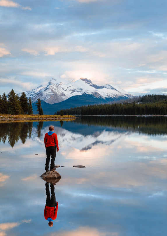 Person on shores of Maligne Lake, Alberta