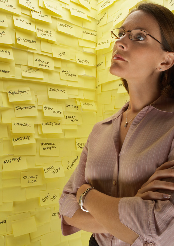Woman staring at post-it notes