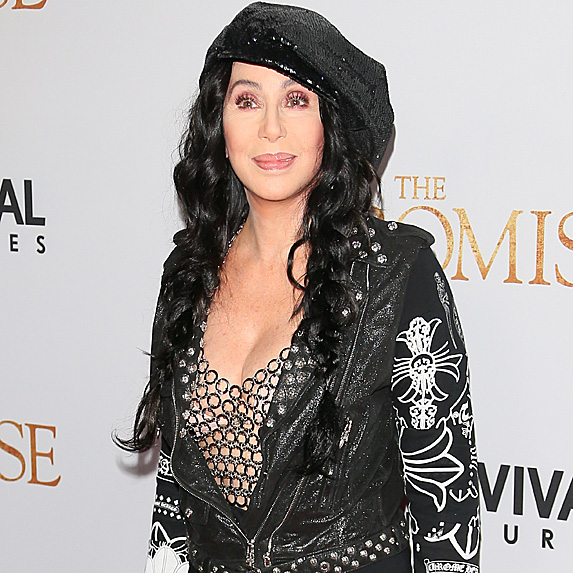 Cher in a bedazzled black leather jacket