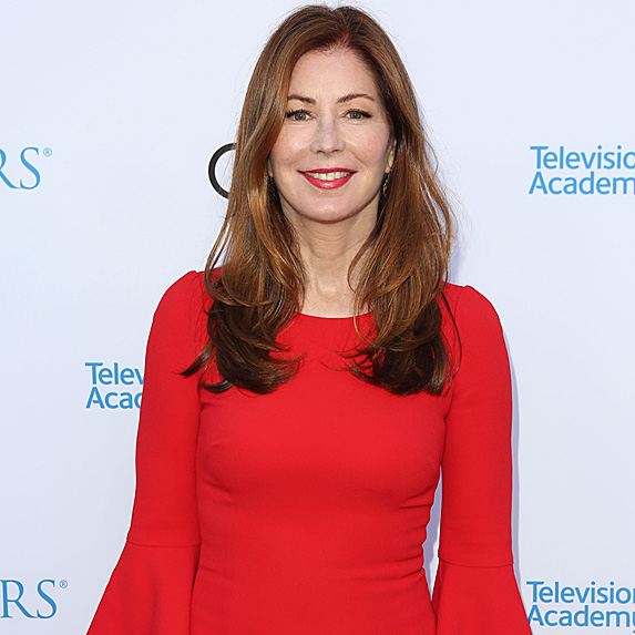 Dana Delany smiling in red