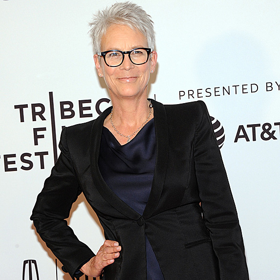 Jamie Lee Curtis poses with one hand on hip