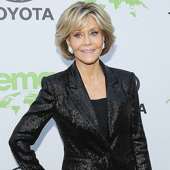 Jane Fonda smiles with one hand on hip