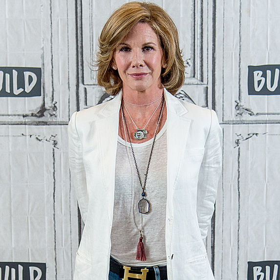 Melissa Gilbert in a white tshirt, jeans and a white blazer
