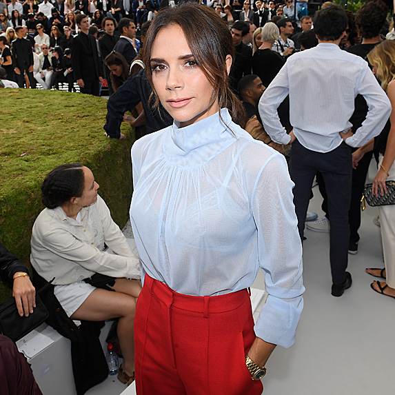 Victoria Beckham in a blouse and trousers