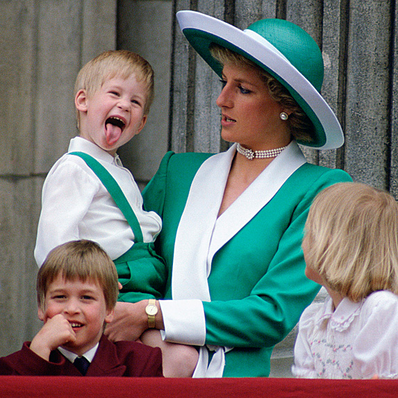 Harry sticking his tongue out while in Diana's arms at 1988 Trooping the Colour