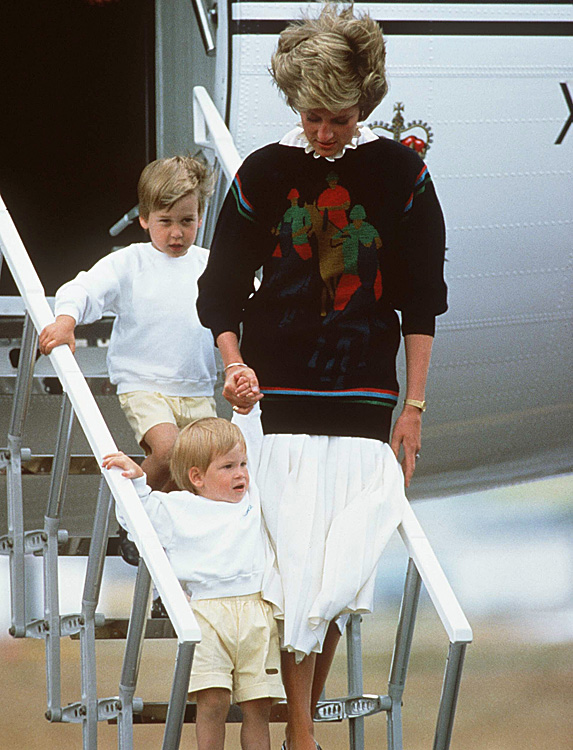 Diana, William and Harry walking down stairs of plane