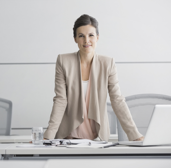 Confident businesswoman in light-coloured outfit