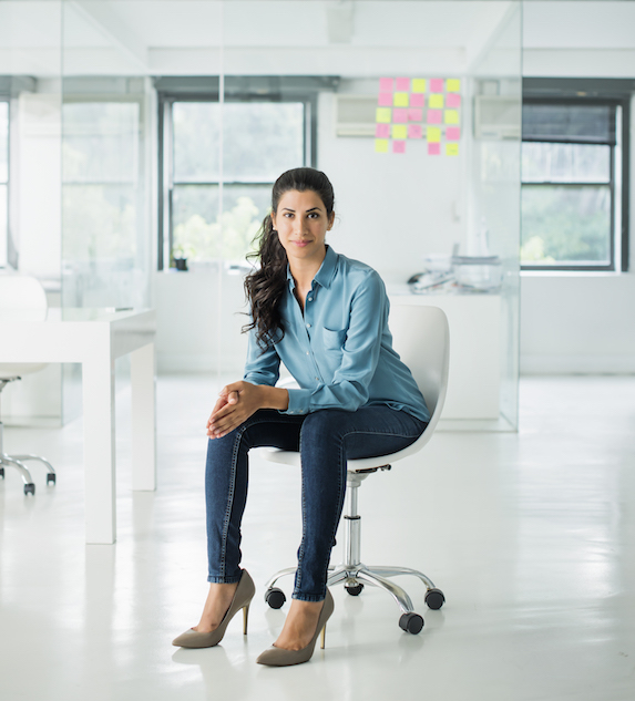 Woman dressed casually in an office environment