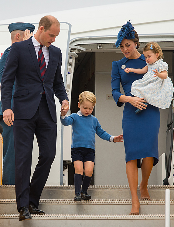 William, George, Kate and Charlotte walking down stairs of plane