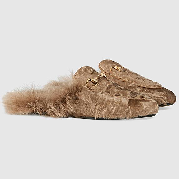 Pair of furry khaki slippers