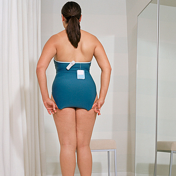 Rear view of woman in one-piece in fitting room
