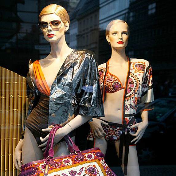 Two mannequins in over-the-top swimwear