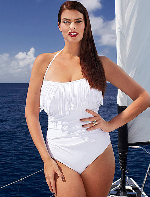 Woman in white fringed one-piece