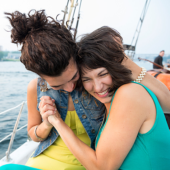 Two woman hugging on a boat