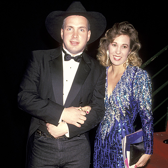 Garth Brooks and Sandy Mahl arm-in-arm at event