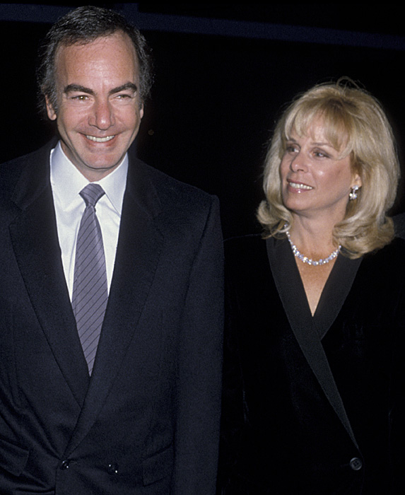 Neil Diamond and Marcia Murphey smiling at event