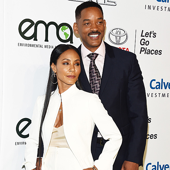 Jada Pinkett Smith and Will Smith pose on red carpet