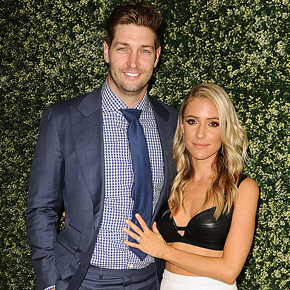 Jay Cutler and Kristin Cavallari in front of greenery