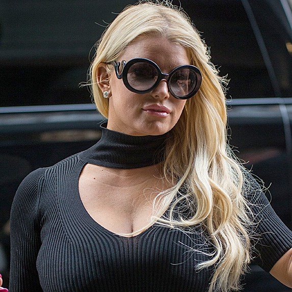 Jessica Simpson wears large sunglasses with her hair over her shoulders