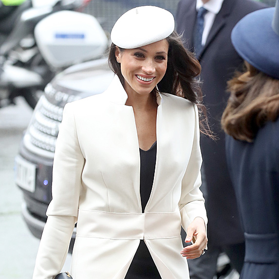 Meghan in white jacket and beret