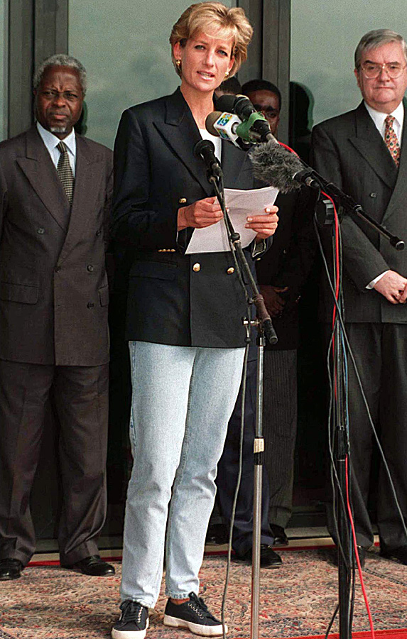 Princess Diana speaking on podium in coat and jeans