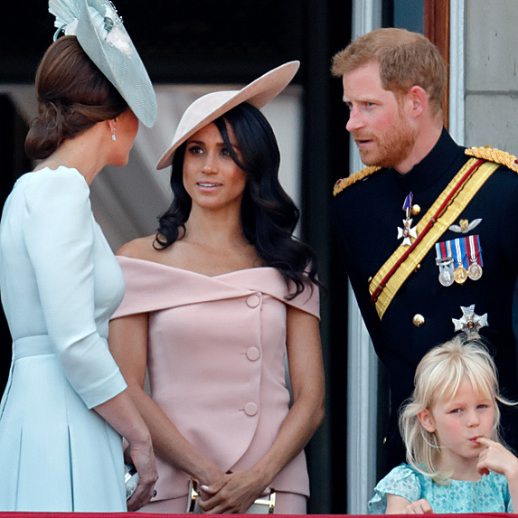 Meghan chatting with Kate and Harry on Buckingham Palace balcony