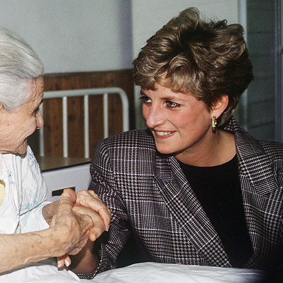 Princess Diana meeting with patient wearing plaid jacket