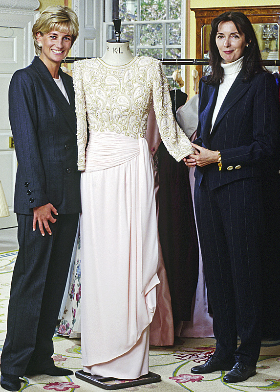 Princess Diana and designer Catherine Walker flank mannequin wearing white gown