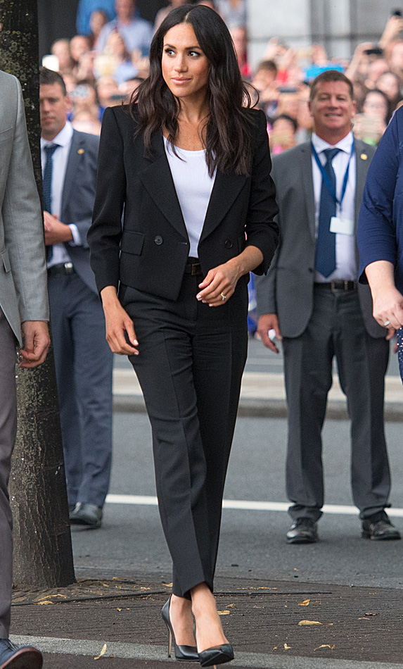Meghan in black suit with white top