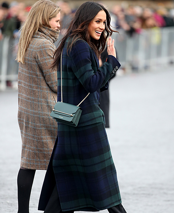 Meghan in green and blue tartan coat waving to crowd