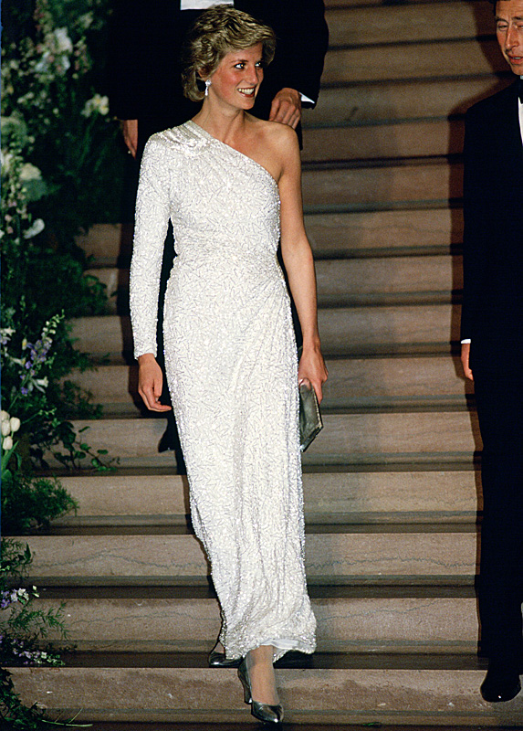 Diana coming down staircase in white gown