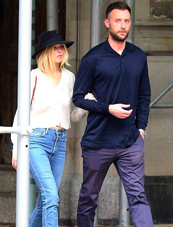 Jennifer Lawrence and Cooke Maroney walking arm in arm in NYC