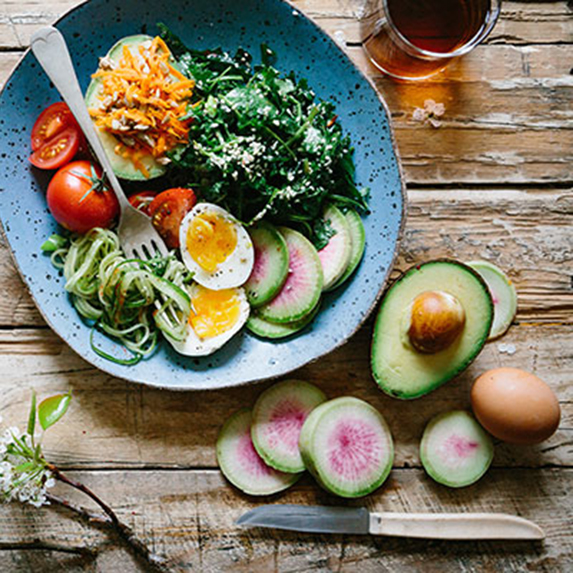 healthy salad with avocado cheese and eggs