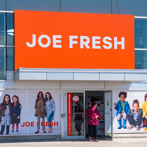 Facade of a Joe Fresh clothing store. The brand is a fashion