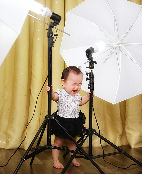 Baby girl crying during photo session