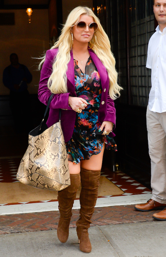 Jessica Simpson wears tall boots, floral dress and purple overcoat