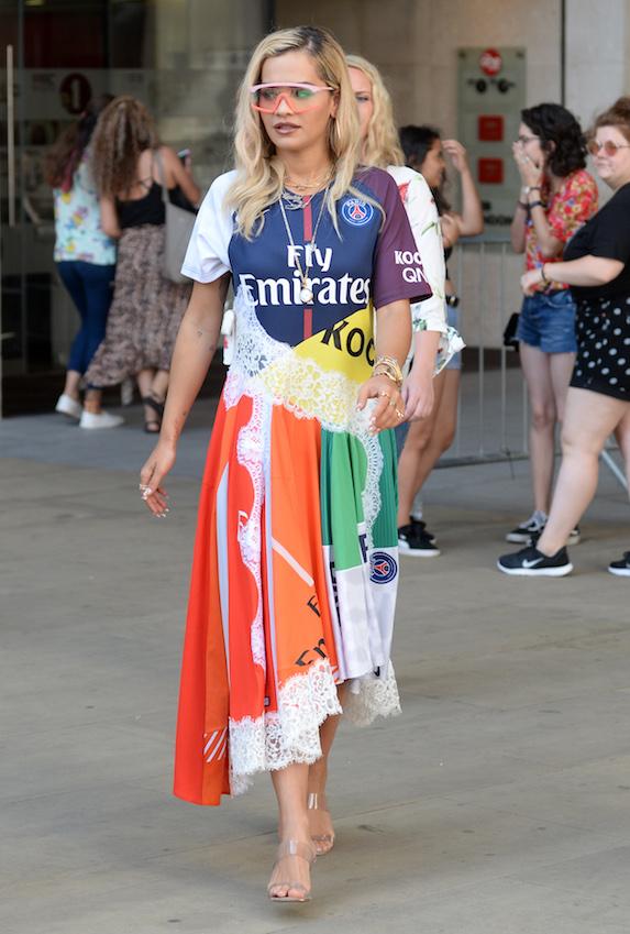 Singer Rita Ora photographed wearing a multi-coloured dress