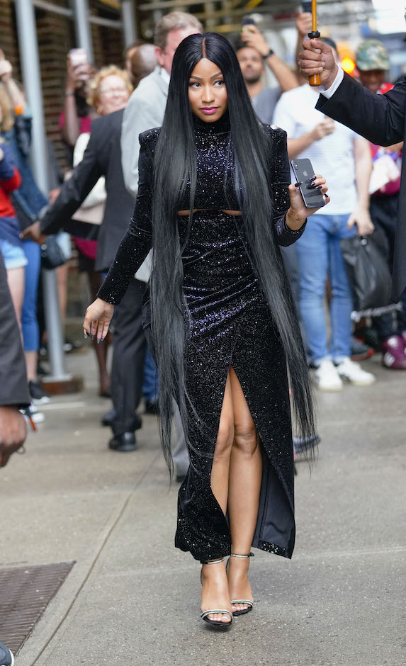 Nicki Minaj photographed in a black gown with long black extensions